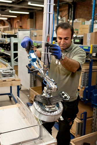 man with industrial robot and Gigant tools